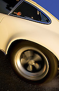 Image of a sports car rear quarter and spinning wheel in California, 1972 Porsche 911 T RS Fuchs, property released