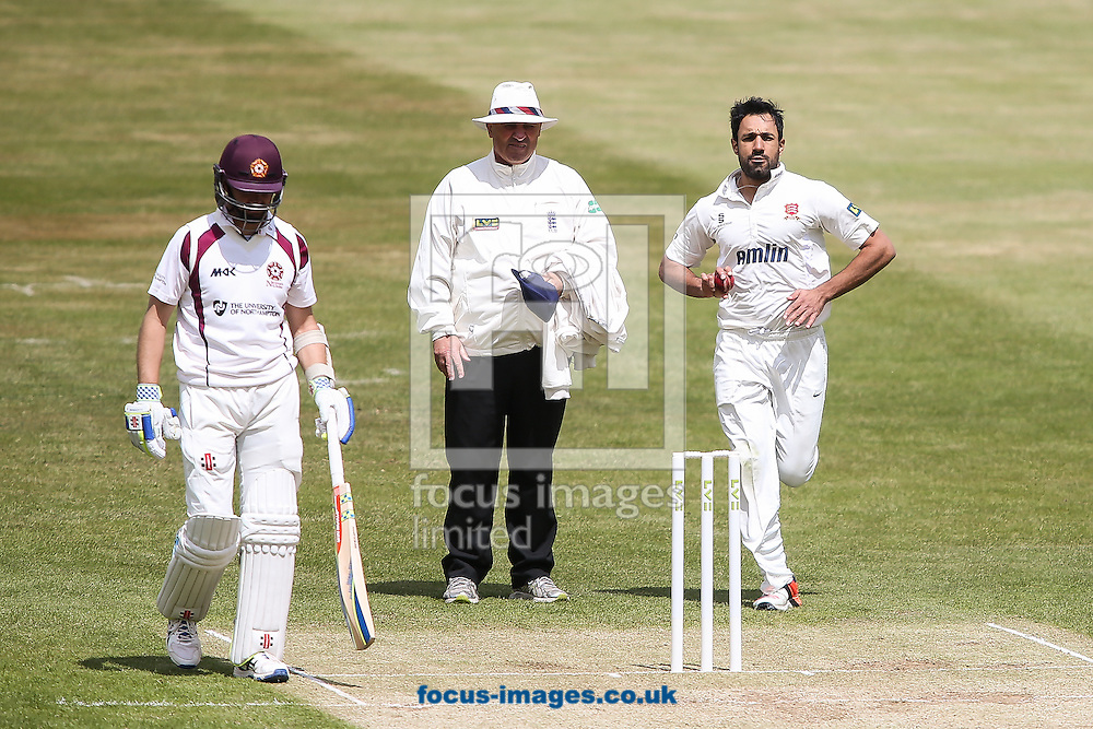 Ravi Bopara of Essex (right) in delivery stride during the LV County Championship Div Two match at the County Ground, Northampton<br /> Picture by Andy Kearns/Focus Images Ltd 0781 864 4264<br /> 08/06/2015
