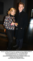 Designer TRACEY BOYD and her husband musician ADRIAN WRIGHT, at a party in London on 16th February 2004.PRS 85