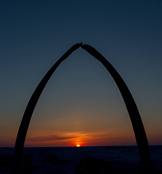 The sun sets at the top of the world. Here lies the largest Inupiat Eskimo village of Utqiagvik, formerly Barrow.