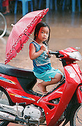 Stung Trang, Cambodia  A four-year old awaits for her dad on a motorcycle. (Essdras M Suarez/ Globe Staff)