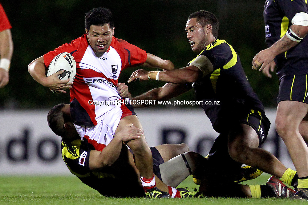 Counties' William Peace is tackled. Pirtek NZRL National Premiership Rugby League match, Counties Manukau Stingrays v Wellington Orcas at Mt Smart Stadium, Auckland, New Zealand. Monday 10th September 2012. Photo: Anthony Au-Yeung / photosport.co.nz