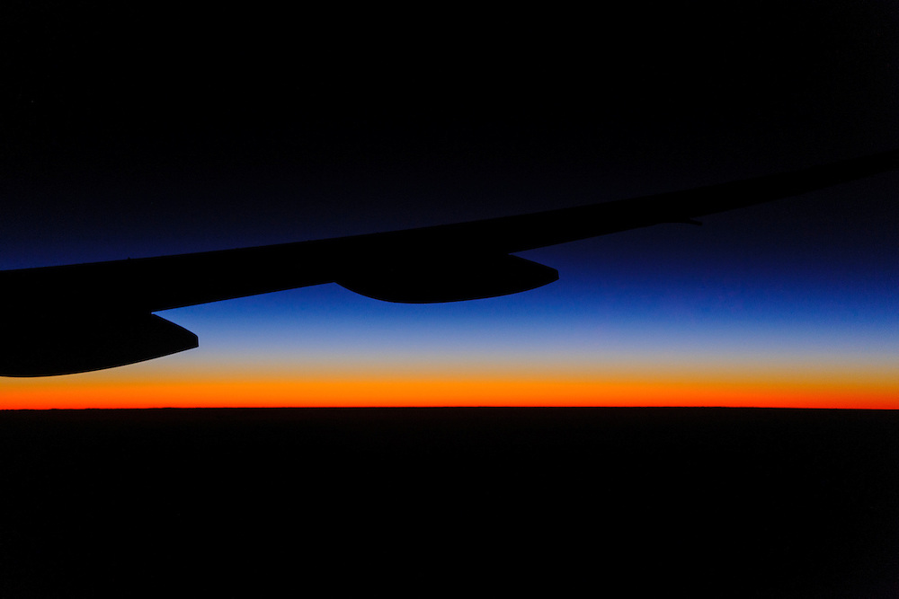 Dawn as seen through the window of a Boeing 777 during a flight from Sydney, Australia to Los Angeles, California.