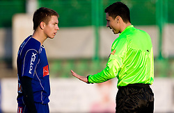 Robert Kurez of Drava and referee Slavko Vincic at 18th Round of PrvaLiga football match between NK Olimpija and NK Labod Drava, on November 21, 2009, in ZAK, Ljubljana, Slovenia. Olimpija defeated Drava 3:0. (Photo by Vid Ponikvar / Sportida)