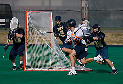 Virginia attackman Danny Glading (9) in action against Navy.  The Virginia Cavaliers scrimmaged the Navy Midshipmen in lacrosse at the University Hall Turf Field  in Charlottesville, VA on February 2, 2008.