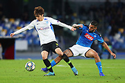Allan of Napoli (R) and Junya Ito of Genk (L) in action during the UEFA Champions League, Group E football match between SSC Napoli and KRC Genk on December 10, 2019 at Stadio San Paolo in Naples, Italy - Photo Federico Proietti / ProSportsImages / DPPI