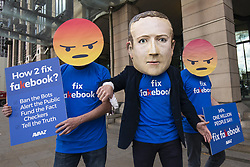 April 26, 2018 - London, London, UK - London, UK. Campaigners from Avaaz with a giant Mark Zuckerberg head protest outside Portcullis House to call on MPs to 'fix facebook'. Facebook's CTO Mike Schroepfer is appearing before a Select Committee. (Credit Image: © Rob Pinney/London News Pictures via ZUMA Wire)