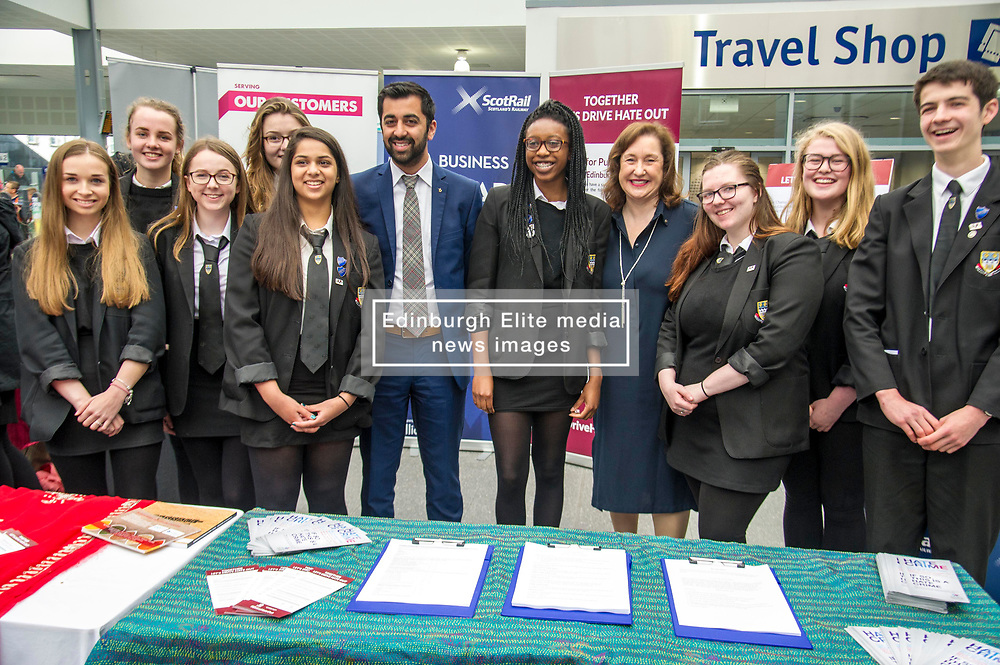 Pictured: Mr Yousaf with students from Currie High School<br /> Humza Yousaf, MSP, minister for Transport and the Islands joined the Edinburgh Community Safety Partnership as they officially launched Edinburgh's Transport Charter aimed at eradicating hate crime on all forms of transport in the city. Each of the organisations involved with the partnership will outline their approach to responding to incidents.  The launch will be followed by two days of action where representatives will be in transport hubs, promoting an understanding of hate crime, raising awareness of the charter and how to report unacceptable behaviours. Charter Representatives: Transport and Environment Convener, Lesley Macinnes, Alex Hynes from the Scotrail Alliance, Michael Powell from Edinburgh Trams, Jason Hackett from First Buses, Superintendent Richard Horan from Police Scotland, Chief Inspector Sue Maxwell from British Transport Police and Transport Scotland. Allister McKillop Vice Chair of Equality Transport Advisory Group (ETAG) and representatives from the Access Panel, Hollaback, SCOREScotland, NKS, Edinburgh Women's Interfaith Group and SESTran along with students from Currie High School<br /> <br /> Ger Harley | EEm 27 June  2017
