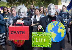 © Licensed to London News Pictures. 09/10/2019. London, UK. Extinction Rebellion activists dressed as Chancellor Sajid Javid carry boxes and briefcases saying LIFE and DEATH as they take part in a third day of protests in central London. The climate change group intend to blockade the Westminster area for two weeks to demand that the government takes immediate and decisive action on climate change. Photo credit: Peter Macdiarmid/LNP
