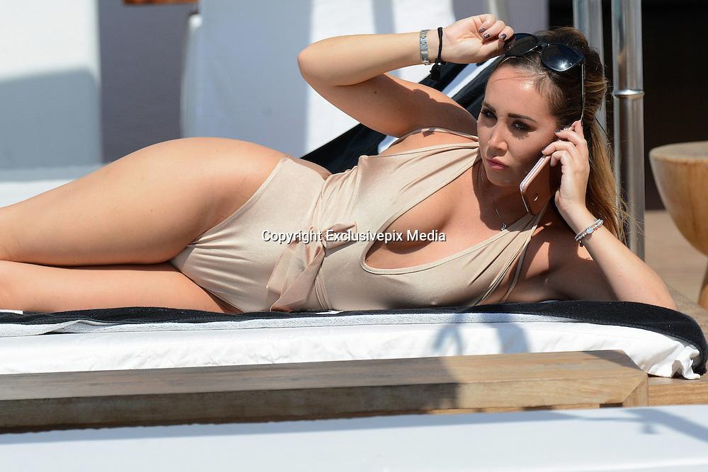 *****EXCLUSIVE*****<br /> Mykonos island, Greece, 12 September 2016<br /> model Lauryn Goodman in golden swim wear and Greek style sexy dress on the beach in Greece.<br /> &copy;Exclusivepix Media