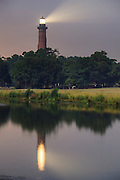 When I arrived in the early morning to teach a  private photo workshop at the Corolla lighthouse, it was very smoky and hazy from a fire across the Currituck sound. In this photograph I took advantage of the smoky haze to emphasize the light from the lighthouse.