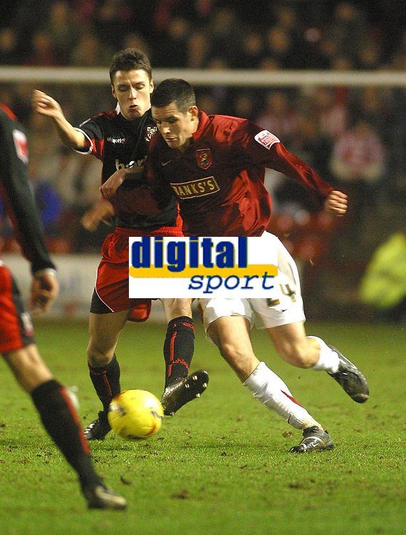 Photo: Dave Linney.<br />Walsall v Lincoln City. Coca Cola League 2. 16/02/2007.<br />Walsall's (R) tussles with Jeff Hughes.