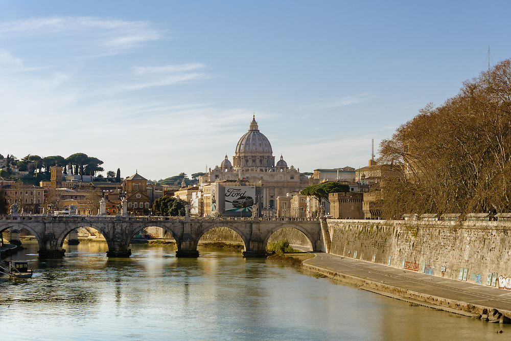 A view of St Peter's Basilica seen across the River Tiber from Pont St Angelo in Rome Italy