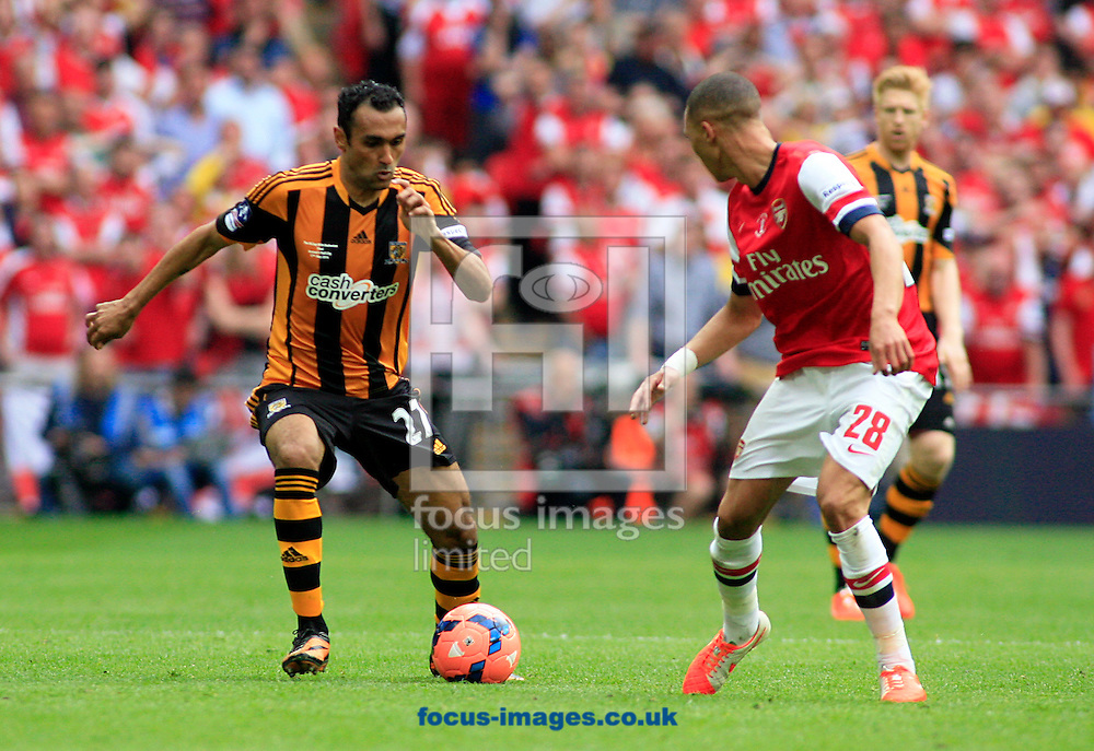 Kieran Gibbs (right) of Arsenal faces Ahmed Elmohamady of Hull City during the The FA Cup Final match at Wembley Stadium, London<br /> Picture by Richard Gould/Focus Images Ltd +44 7855 403186<br /> 17/05/2014