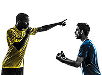 two men soccer player and referee in silhouette on white background