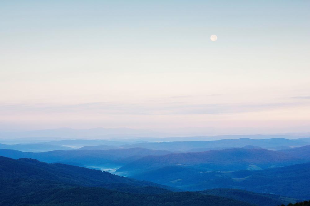Full moon and view from the Polish-Slovakian border on the peak of Mount Durkovec (1189 m) into Slovakia. Runina area, Slovakia / Poland.