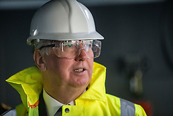 United Kingdom Secretary of State for Defence Michael Fallon on the bridge, during a tour of the Queen Elizabeth Aircraft Carrier, which is under construction at the Babcock site in Rosyth dockyard.