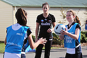 Sofia Fenwick of the Tactix coaching a warm up drill of the Southbridge Netball Club with Claire Lambie, 13 during the ANZ Championship Roadshow, Win a Warmup, held at the Selwyn Netball Centre, Lincoln. 17 May 2014 Photo: Joseph Johnson/www.photosport.co.nz