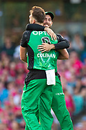 Melbourne Stars player Jackson Coleman and Melbourne Stars player Glenn Maxwell celebrate the wicket of Sydney Sixers player Daniel Hughes at the Big Bash League cricket match between Sydney Sixers and Melbourne Stars at The Sydney Cricket Ground in Sydney, Australia