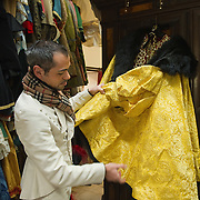 VENICE, ITALY - JANUARY 20:  Choreographer Raffaele Dessi of the historic atelier Pietro Longi examines an Henry VIII reproduction costume made with real gold thread on January 20, 2012 in Venice, Italy. This is one of the busiest periods of the year for the atelier as the next few weeks the streets and canals of Venice will be filled with people attending the carnival,  wearing highly-decorative and imaginative carnival costumes and masks.
