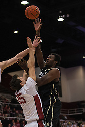 Colorado forward Wesley Gordon, right, shoots over Stanford forward Rosco Allen (25) during the first half of an NCAA college basketball game in Stanford, Calif., Sunday, Jan. 3, 2016. Colorado won 56-55. (AP Photo/Jason O. Watson)