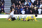 Derby County defender Cyrus Christie (2) is brought down by Sheffield Wednesday midfielder Kieran Lee (20) during the Sky Bet Championship match between Derby County and Sheffield Wednesday at the iPro Stadium, Derby, England on 21 February 2015. Photo by Aaron Lupton.