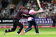 Eoin Morgan of Middlesex hits the ball to the boundary for four runs during the Vitality T20 Blast South Group match between Somerset County Cricket Club and Middlesex County Cricket Club at the Cooper Associates County Ground, Taunton, United Kingdom on 30 August 2019.