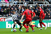 Ayoze Perez (#17) of Newcastle United tries to stab away a shot under pressure from Jonathan Hogg (#6) of Huddersfield Town during the Premier League match between Newcastle United and Huddersfield Town at St. James's Park, Newcastle, England on 31 March 2018. Picture by Craig Doyle.