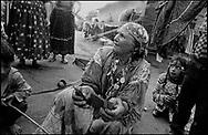 "TALIA MIHA, MOTHER OF ""BULIBAS"" ION, READING MY TAROT CARDS. SINTESTI, ROMANIA, 1991..©JEREMY SUTTON-HIBBERT 2000..TEL./FAX.  +44-141-649-2912..EMAIL J.S.HIBBERT@BTINTERNET.COM."