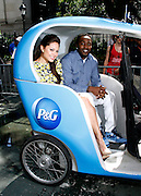 """Vanessa Lachey and Hakeem Nicks pose as P&G Launches """"Everyday Effect Campaign"""" in Herald Square in New York City, New York on June 19, 2013."""