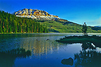 Reflections of 10,514 ft. Beartooth Butte in Beartooth Lake of the Beartooth Mountains and the Shoshone National Forest.  Wyoming.