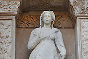Statue of Arete, Greek goddess of virtue, from the facade of the Library of Celsus, Ephesus, Izmir, Turkey. The library was built 110-135 AD under Consul Julius Celsus Polemaenus, governor of the province of Asia. Celsus paid for the construction with his own personal wealth, and is buried in a sarcophagus beneath it. The library held nearly 12,000 scrolls in cupboards in niches in the double walls, which protected the documents from temperature and humidity. Ephesus was an ancient Greek city founded in the 10th century BC, and later a major Roman city, on the Ionian coast near present day Selcuk. Picture by Manuel Cohen