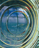 Fresnel Lighthouse lens with reflection of coastline.<br />