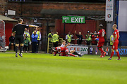 Referee points to the spot as Marvin McCoy gives away a penalty during the Capital One Cup match between York City and Bradford City at Bootham Crescent, York, England on 11 August 2015. Photo by Simon Davies.
