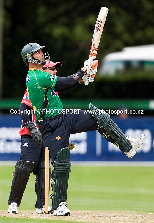 Central Stags player Mathew Sinclair hits a six off the bowling of Craig mcMillan, the first ball of his innings of 67. Men's 1-Day, Canterbury Wizards v Central Stags at Mainpower Oval, Rangiora, Tuesday 08 December 2009. Photo : Joseph Johnson/PHOTOSPORT