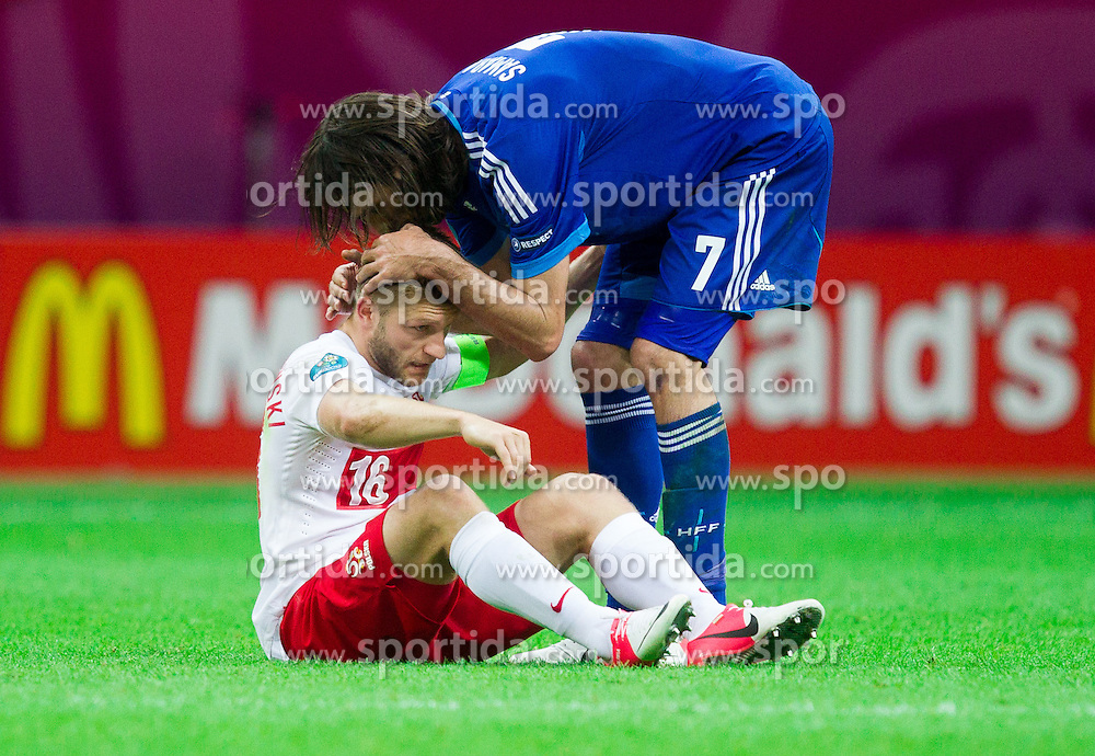 Jakub Blaszczykowski of Poland with Giorgos Samaras  of Greece after  the UEFA EURO 2012 group A match between Poland and Greece at The National Stadium on June 8, 2012 in Warsaw, Poland.  (Photo by Vid Ponikvar / Sportida.com)