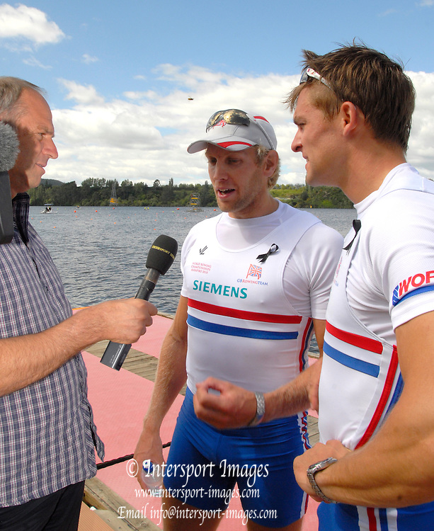 Hamilton, New Zealand, 2010  World Rowing Championships, Lake Karapiro Saturday  06/11/2010 GBR, M2-, Sir Steve REDGRAVE [left], interviews Andrew TRIGGS HODGE [centre], and Peter REED [right], after they had won Silver [Mandatory Credit Karon Phillips/Intersport Images]