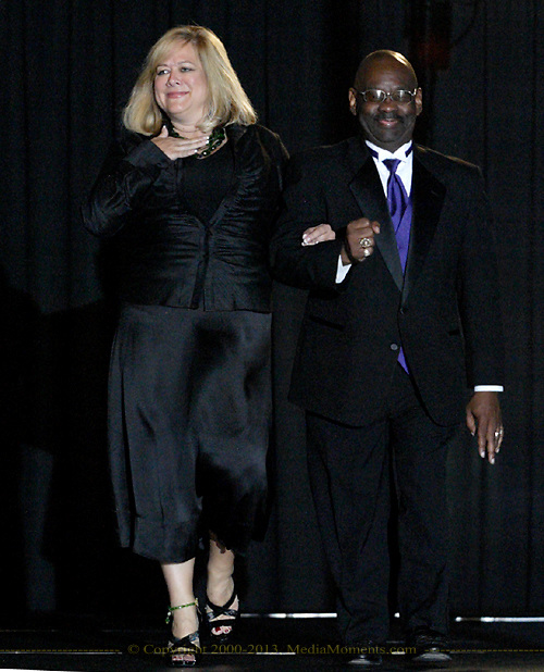 Community role models Debbie Lieberman (left) and Willie Terrell, Jr on the runway during the 23rd Annual Bravo! Fashion Show at the Sinclair Conference Center in downtown Dayton, Friday, October 1, 2010.