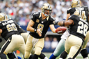 New Orleans Saints quarterback Drew Brees (9) hands the ball to running back Mark Ingram (28) against the Dallas Cowboys at Cowboys Stadium in Arlington, Texas, on December 23, 2012.  (Stan Olszewski/The Dallas Morning News)