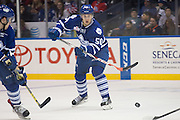 Marlies defenseman Viktor Loov passes the puck during a game against the Rochester Americans in Rochester, New York, USA on Friday, December 4, 2015.