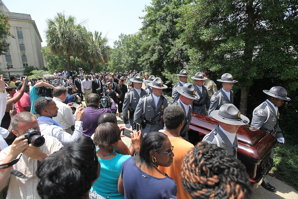 Loved ones of state Sen. Clementa Pinckney follow nine troopers carrying Pinckney's casket into the S.C. Statehouse in Columbia on Wednesday, a week after Pinckney and eight other people were fatally shot at Emanuel AME Church in downtown Charleston. (ANDREW KNAPP/STAFF)
