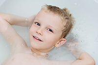 Little Boy Floating in Bathtub