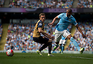 Fernando of Manchester City (right) gets past Aaron Ramsey of Arsenal during the Barclays Premier League match at the Etihad Stadium, Manchester<br /> Picture by Russell Hart/Focus Images Ltd 07791 688 420<br /> 08/05/2016