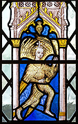 Church of Saint Mary of the Assumption, Ufford, Suffolk, England, UK fifteenth century stained glass window of feathered angel with thurible