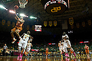 WACO, TX - JANUARY 25: Demarcus Holland #2 of the Texas Longhorns drives to the basket against the Baylor Bears on January 25, 2014 at the Ferrell Center in Waco, Texas.  (Photo by Cooper Neill/Getty Images) *** Local Caption *** Demarcus Holland