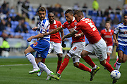 Backheel pass by Reading's Carlos Orlando Sa during the Sky Bet Championship match between Reading and Charlton Athletic at the Madejski Stadium, Reading, England on 17 October 2015. Photo by Mark Davies.