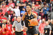 LUBBOCK, TX - MARCH 1: Kerwin Roach Jr. #12 of the Texas Longhorns brings the ball up court during the game against the Texas Tech Red Raiders on March 1, 2017 at United Supermarkets Arena in Lubbock, Texas. Texas Tech defeated Texas 67-57. (Photo by John Weast/Getty Images) *** Local Caption *** Kerwin Roach Jr.