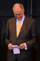 © London News Pictures. 04/05/2012. London, UK. KEN LIVINGSTONE looks down at his papers as he prepares to make a speech after loosing to Boris Johnson. BORIS JOHNSON speaks after being elected as Mayor of London at London City Hall on May 4, 2012. Johnson, a Conservative member of Parliament, defeated Ken Livingstone to become mayor of London for a second term. Photo credit: Stephen Simpson/LNP