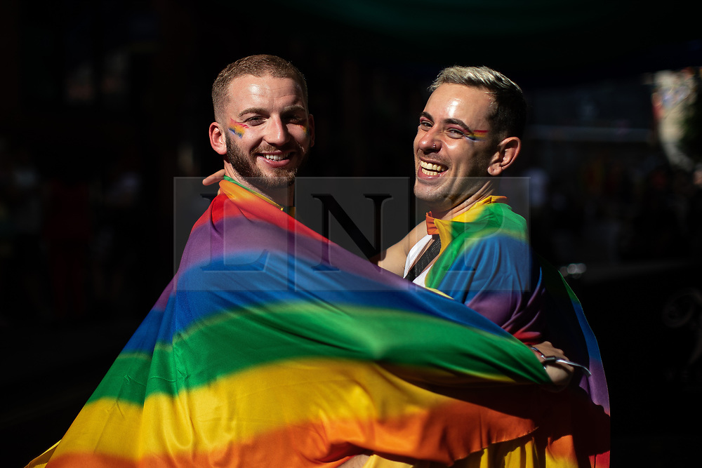© Licensed to London News Pictures . 23/08/2019 . Manchester , UK . Couple DAN BENBOW (27) and JAMIE ROOKE (30) on Canal Street . People out in Manchester's Gay Village during the first day of Manchester Pride's Big Weekend . Photo credit : Joel Goodman/LNP