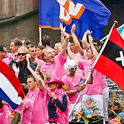 NLD/Amsterdam/20100807 - Boten tijdens de Canal Parade 2010 door de Amsterdamse grachten. De jaarlijkse boottocht sluit traditiegetrouw de Gay Pride af. Thema van de botenparade was dit jaar Celebrate, Frits Huffnagel